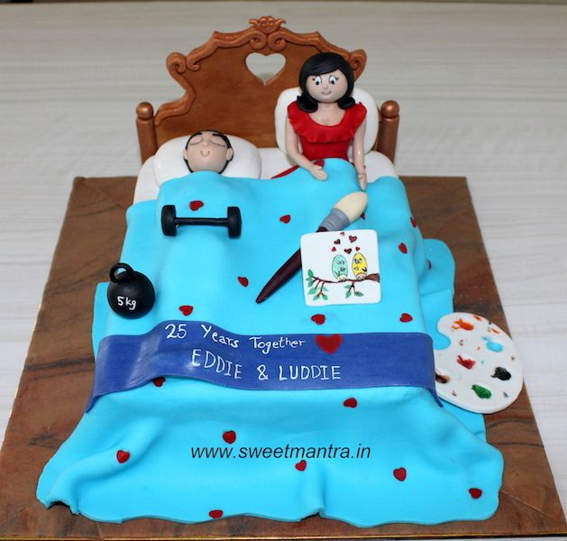 Bed Shaped 3d Designer Cake With Mom Dad Figurines On Bed For