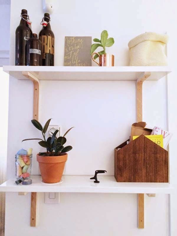 Shelves using bent wood natural wood shelf brackets and Ikea white shelves. / Poppytalk: 9 Awesome Weekend Projects!