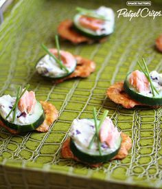 Smoked salmon with cream cheese, olives, cucumbers and chives on Sesame Pretzel Crisps #appetizer