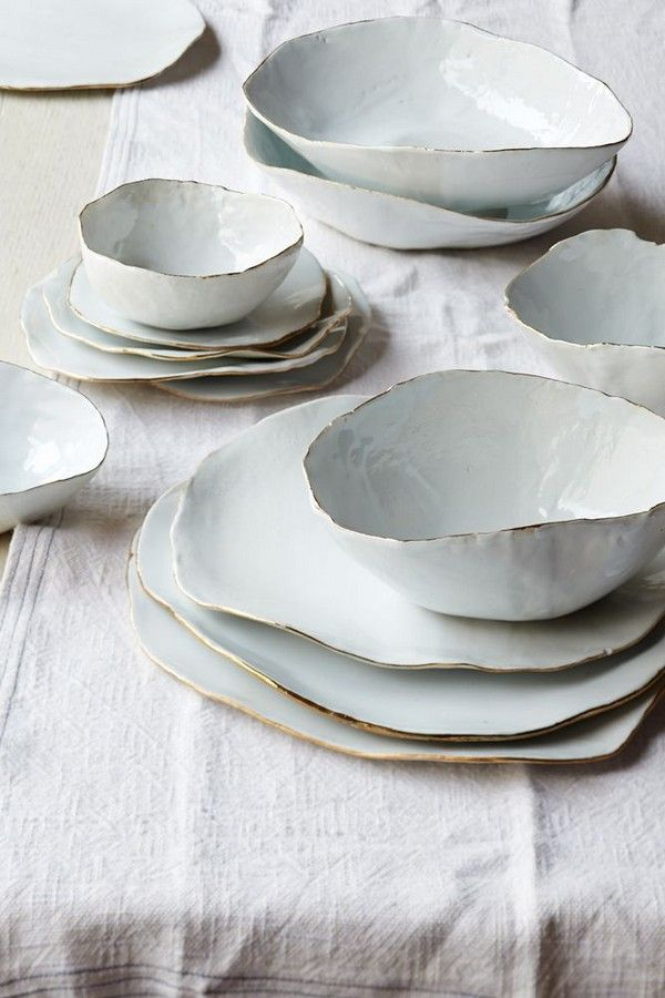 Golden rimmed white crockery for the breakfast table. White and gold in such an elegant combo and the rustic handmade finish on these bowls are pure class
