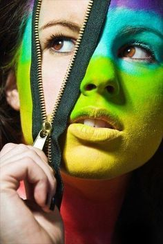 What I think stood out within this image is that although the photo is only on the models face and no more. The model within the image has evidently been to a make up artist first, and has got multicoloured paint on her face but they've included a stick on zip so on eye is normal skin colour. I feel this adds to the image as it is very unusual and not an every day photo.