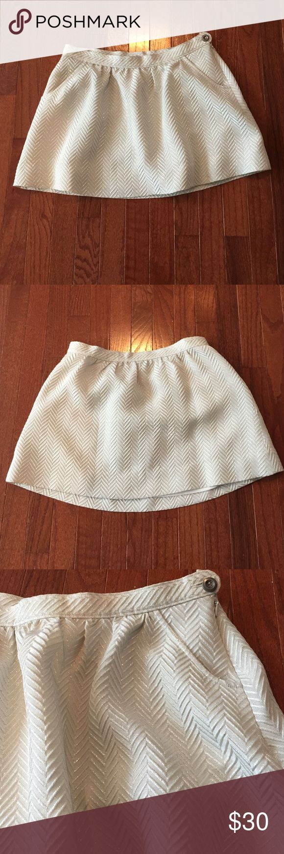 J. Crew Skirt Purchased from J. Crew outlet. Never worn, no stains. Working side zipper. Original button in place and back up button still sewn into skirt. Fabric is creamy metallic color. Tag states fabric as 61% wool, 21% silk, 10% metallic and 8% cotton. J. Crew Skirts Mini