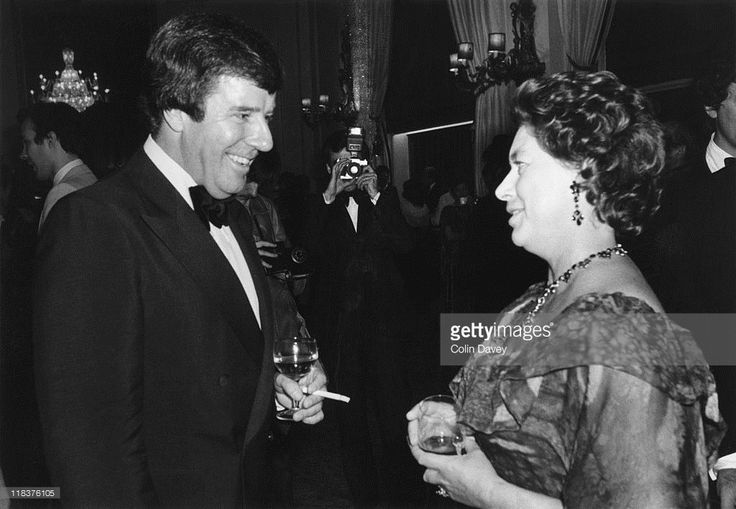 English television presenter Russell Harty (1934 - 1988) chats with Princess Margaret whilst attending a performance by the New York City Ballet at the Royal Opera House in London, 17th September 1979.
