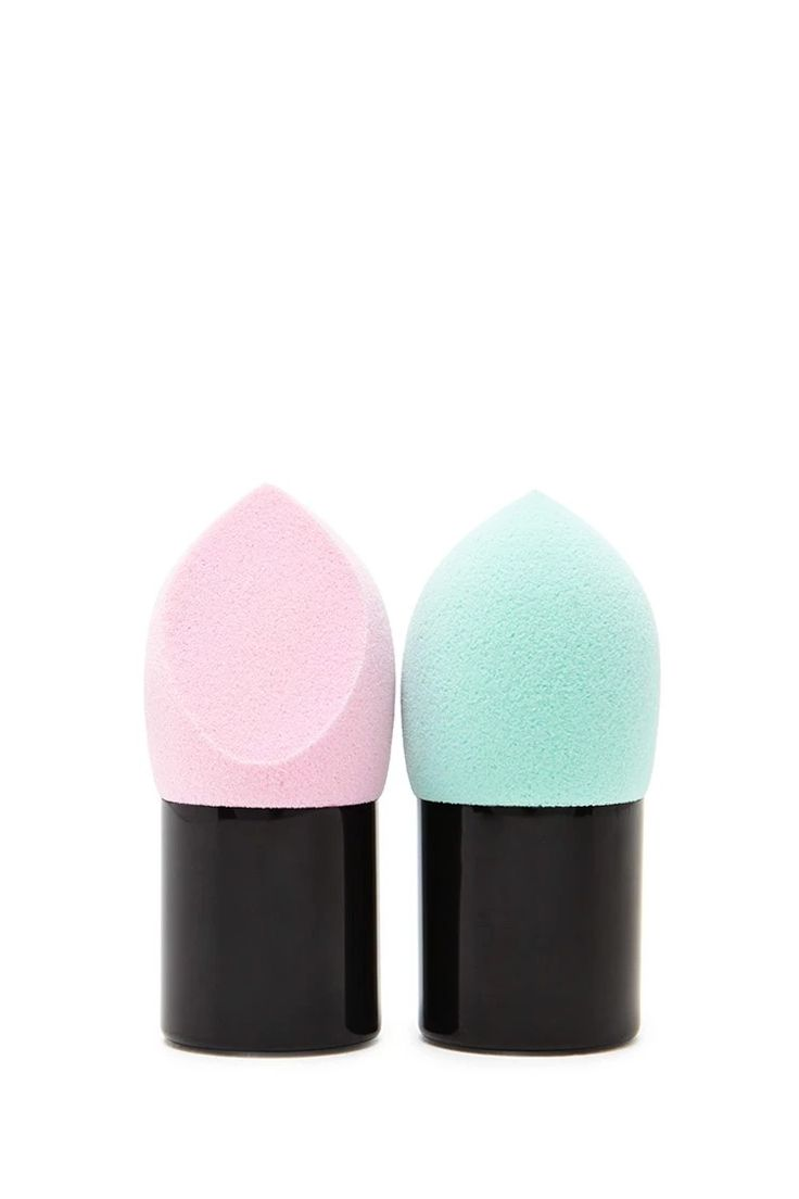A set of two mini makeup sponges with pointed tips. #beautymark