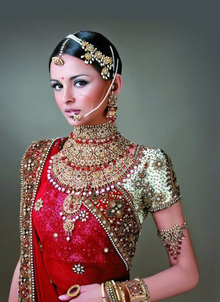 Indian Bride in Red & Gold. I got married in red and gold and I always wanted to pierce my nose for my wedding day so I could put in that hoop. I didn't unfortunately...
