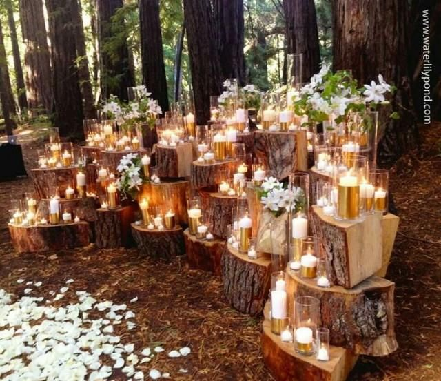 Wow! Dramatic stacked wood stump backdrop for wedding ceremony altar.