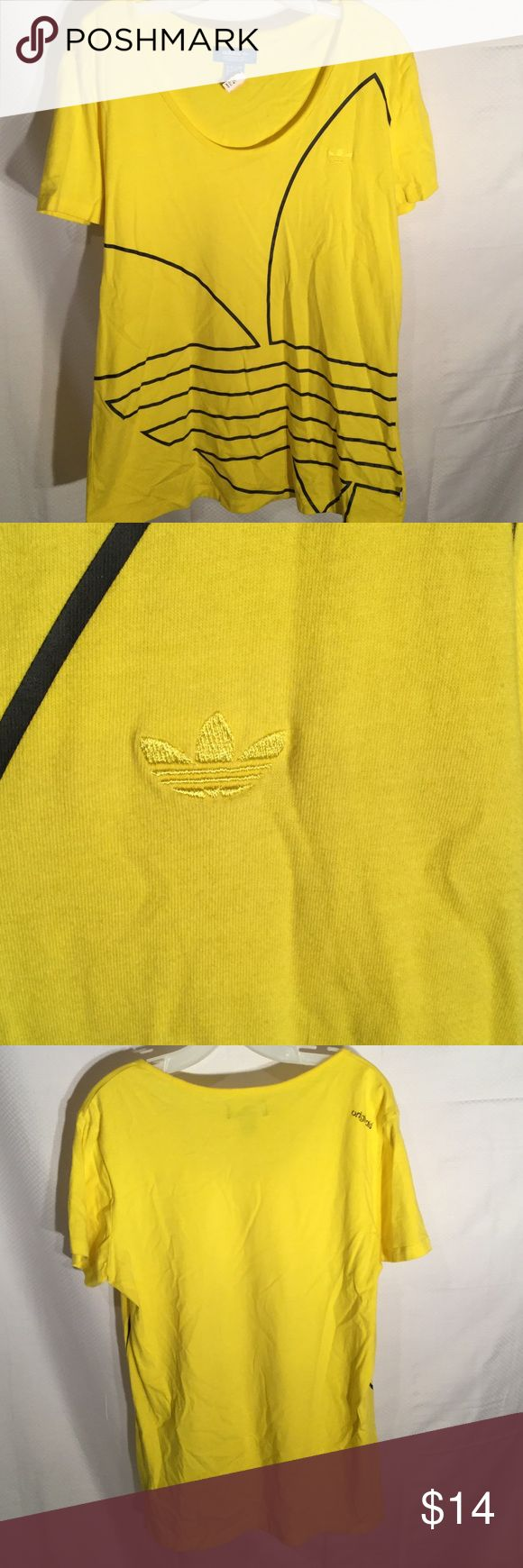 Adidas ladies fun t shirt Ladies adidas yellow with black details short sleeved t shirt. Size L but generous and will cover butt . The black design is really the adidas logo blown up . Super cute and practical in a sunny yellow color. Worn once only Adidas Tops Tees - Short Sleeve