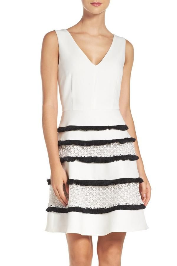 Fancy with Fringe - 12 Pretty Dresses for Easter Sunday - Southernliving. This white fit-and-flare dress has black fringe on the skirt broken up by white lace details. It is perfect for a big Easter gathering.  Buy It: Adelyn Rae Stripe Fit and Flare Dress, $100; nordstrom.com