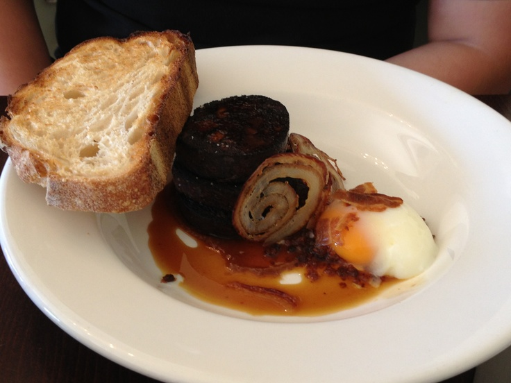 Slow cooked egg with black pudding, brown sauce, pork crackers and meat juices. At Duchess of Spotswood