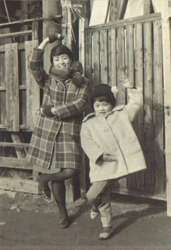 Japanese children striking poses for the camera. Undated vintage photo
