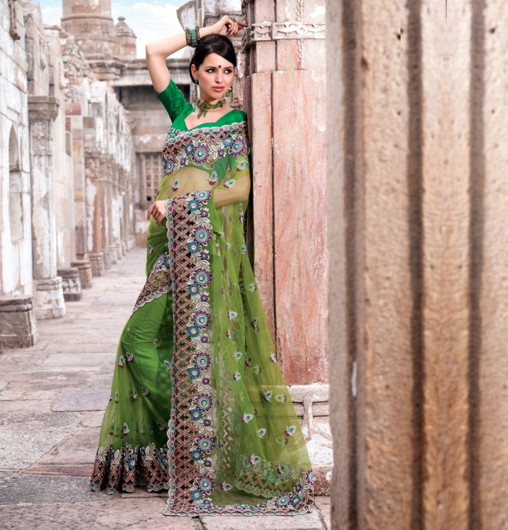 Pista green colour saree giving charming look is engraved on net, dupian and satin material.    For more details visit www.ashika.com