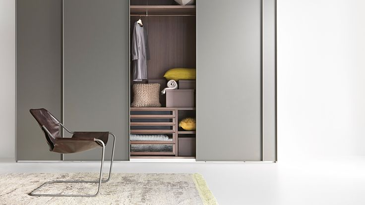 LEMA   The sliding doors of LISCIA are versatile and will fit existing walls with extreme ease. The standard dimensions include 3 heights and 3 widths, but it is also possible to customize the height, width and depth. The door panels can be mat lacquered in the 40 colours of the Lema color trend collection, but are also available as mirror or lacquered glass. The double compartment allows an almost uninterrupted view of the contents.