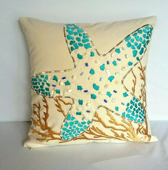 Coastal inspired pillow cover made of baige hand loom fabric. with aqua blue starfish embroidery. With shell bead work. #pillows #coastaldecor #coral #coastal