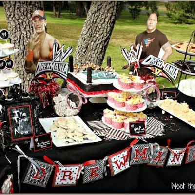 WWE Birthday Party {Wrestling Birthday Party}This awesome wrestling party is perfect for your little wrestling fan! Brista made all of the party decor using her Cricut and Photoshop with the exception of the wrestler half-bodies. The birthday boy helped name the food after the wrestlers and came up withJohn Cena Smores,CM Punk Popcorn and The Big Show Sandwiches. No clowns for this party...a real WWE wrestler! How cool is that!View This Tutorial