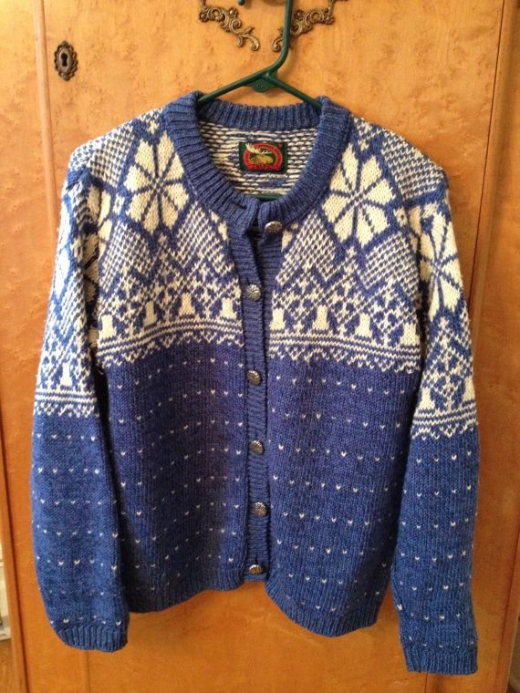 Womens pullovers and cardigans. Traditional and contemporary wool sweaters hand knitted by Icelandic Housewives. The hand knit wool sweaters and wool cardigans are .