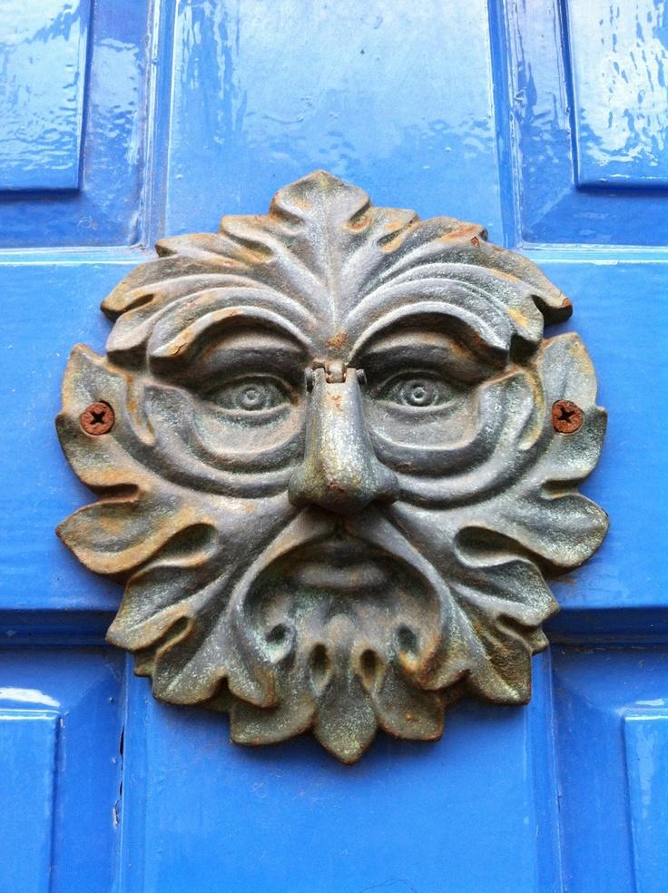 Unusual knocker on door in Tideswell, Derbyshire