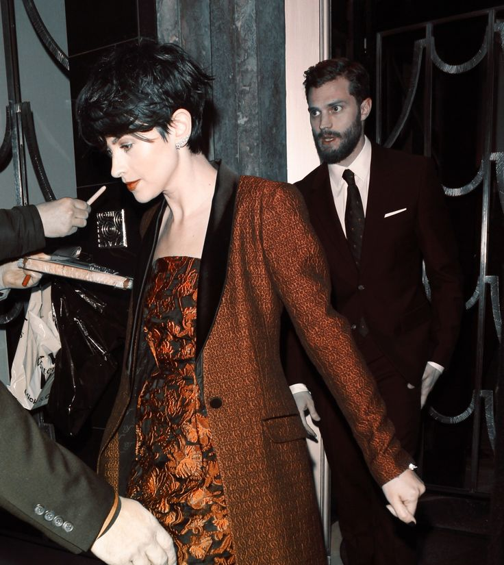Jamie and Amelia leaving Claridges Hotel in London.