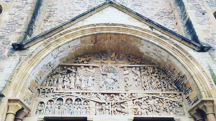 Link in bio#thatchillaxdude  Day 10... Le Soulier - Conques -- the entrance to the church definitely tells a story!  #followyourarrow #travel  #wandern #travelbug #travelgram #wanderlust #notallwhowanderarelost #solotravel #worldtravel #natgeo #wander #explore  #buencamino #europe #love #france #saintjames #chemindesaintjacques #caminofrances #peregrino #caminodesantiago #thewayofsaintjames #gr65 #lechemindesaintjacquesdecompostelle #caminodesantiagodecompostela #santiagodecompostela…