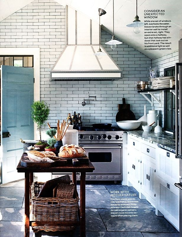 I really really want subway tiles in my future kitchen! This is a big statement in a small space -- organic stone floors. I can dream this for someday :-)