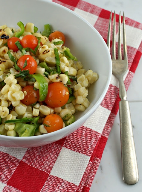 Grilled Corn and Tomato Salad -- Going to try this but with frozen corn and a saute pan to approximate the grill.