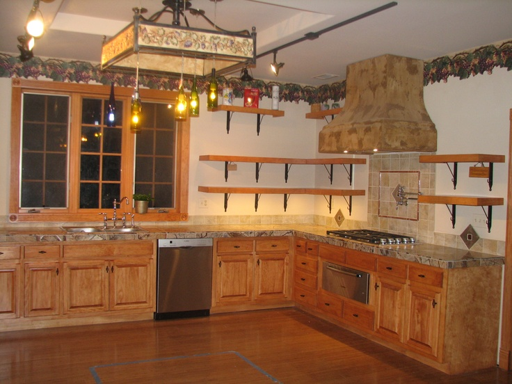 In this one you can see the amazing BOSH dishwasher - can you say 'quiet'?  The floors are bamboo.  Then you see the Grape pot-rack-wine-bottle-lights ... one of a kind light fixture!
