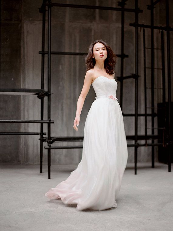 This gown features a sweetheart neckline, Chantilly lace bodice, and hand dyed ombre effect silk skirt. The skirt is made using 6 meters of ivory