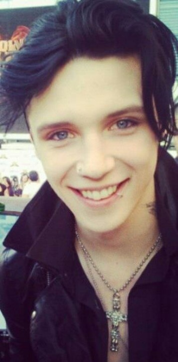 Andy Biersack... I don't understand why people like him feel like they have to wear all the creepy makeup and stuff.... He looks so much better without it and I think a lot of people agree