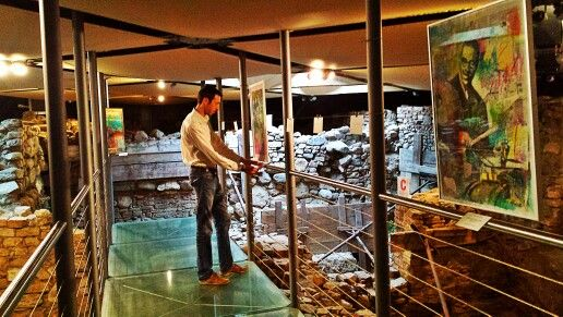 """Preparing my new solo exibition """"Reflections"""" set up inside the underground site of the Roman ruins of my city."""