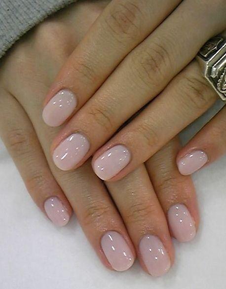 Light pink nail polish.