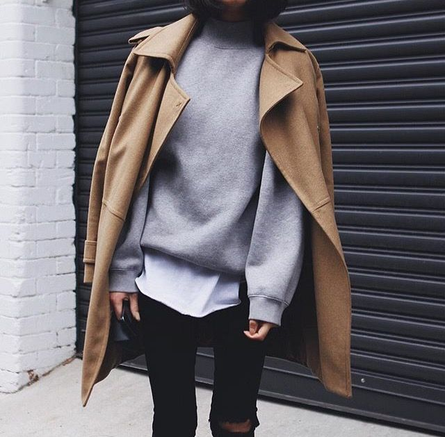 Ripped black jeans, gray sweatshirt and camel colored trench coat