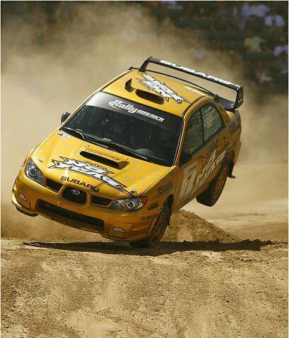 Colin McRae at 2006 X Games! One of the greatest moments I've ever seen in racing! Colin rolled his subie and was able to recover and still managed to finish second to Travis Pastrana, only a half second behind! Completely and totally amazing!