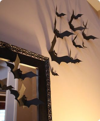 The Pink Porch: Inspiration: Indoor Halloween Decor -- black construction paper bats taped to the walls!