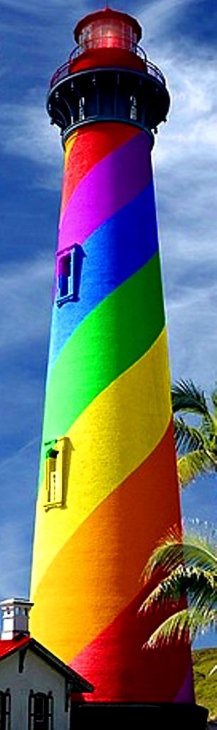 "Rainbow color swirl lighthouse  [per SailorGil on Tumblr:  ""I went back to Flickr where I found the photo … It is the St Augustine lighthouse in Florida, which has black and white stripes … The photographer has used photoshop to do the rainbow stripes.""]"