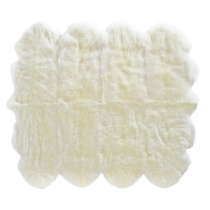 Looking for a rug for a main room? Try something different with a full sheepskin octo. You will actually not want to get off it. The couch may just become inferior to this thing of beauty.  (http://www.classicsheepskins.com/sheepskin-rug-octo/)