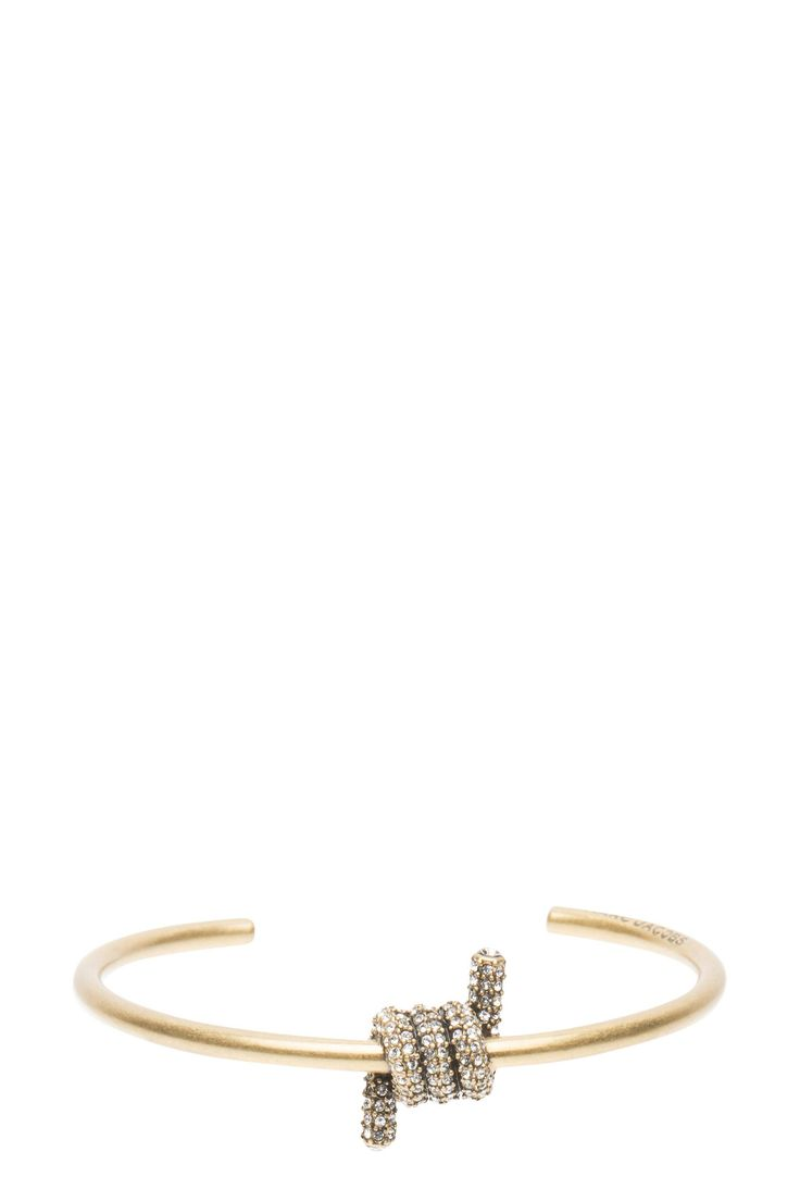 The Marc Jacobs Pavé Twisted Cuff features an artfully crafted, gem embellished charm in the middle of a minimal cuff-style. Style it alone or stack it with your favorite acelets for maximum impact. //70% Brass, 30% SW Stone//