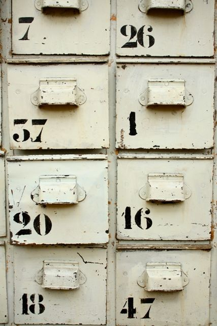Stencilled numbers on an industrial cabinet