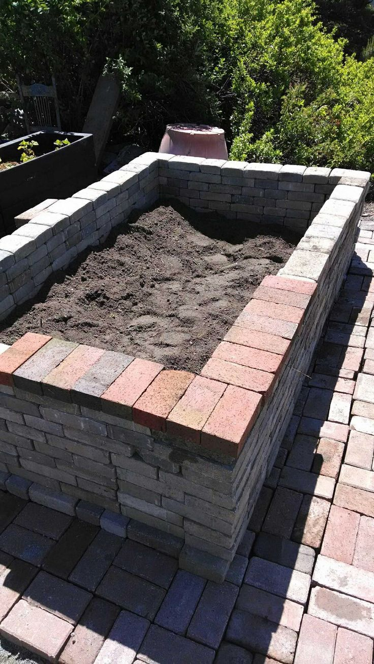 we built this above ground planter with bricks in the yard - Brick Garden 2015