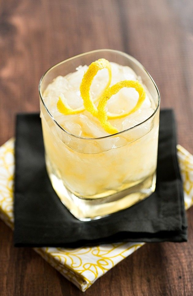 Rusty Nail (scotch, Drambuie, lemon juice, lemon spiral for garnishing)