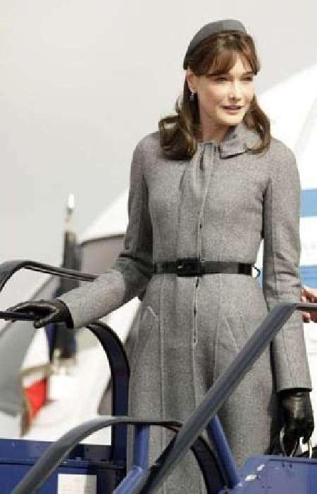 March 28, 2008 - Carla Bruni in Dior, with Nicolas Sarkozy at Heathrow Airport.