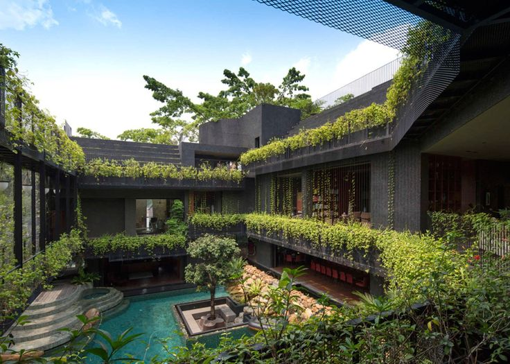 Large family home in Singapore featuring Koi pond, swimming pool and roof terrace