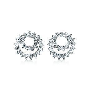 Swirl ear clips of diamonds in platinum. $9800