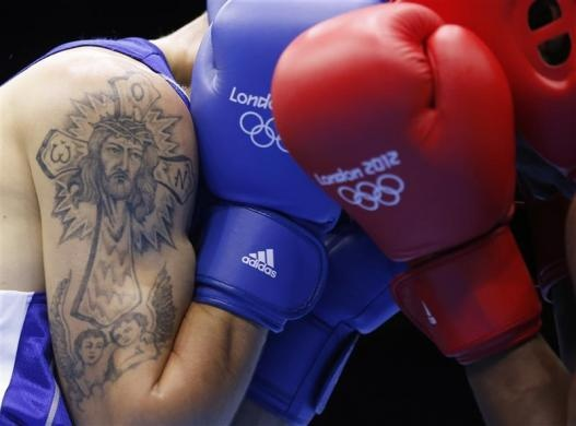 Moldova's Vasilii Belous (L) sports a tattoo as he fights against Tanzania's Selemani Kidunda during the men's welter (69kg) Round of 32 boxing match at ExCeL venue during the London 2012 Olympic Games July 29, 2012.   REUTERS/Murad Sezer