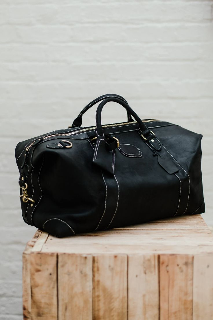 Black Genuine Leather Duffle Bag, Golden Luxury Zips. For the stylish and luxurious travel experience. -Long Adjustable Shoulder Strap -Solid Quality Hardware -Fabric Lining -Inner zipper pocket, laptop sleeve, one cell pocket, one purse pocket. Made out of superior cowhide leather, with a raw vintage look & feel. #leather #leathergoods #leatherwork #leathercraft #leatherbag SWISH & SWANK www.swish-swank.com
