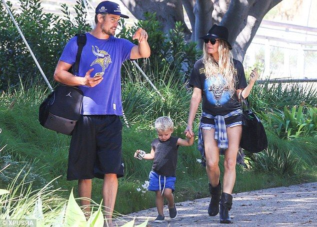 Baby love: Fergie is ready to be a mom for the second time with husband Josh Duhamel, after her new solo album and tour are wrapped; here the family is pictured on September 20 at a Santa Monica, CA park