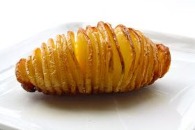 Seasaltwithfood: Hasselback Potatoes.  Watch the tip video on a great way to cut them easily without cutting all the way through.