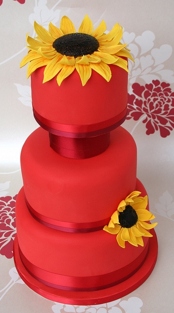 Red Sunflower Wedding Cake posted at Flickr by Flutterby Bakery