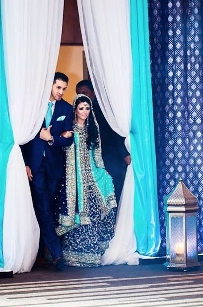 Blue lengha and matching tie for groom at desi engagement party. Blue decor.