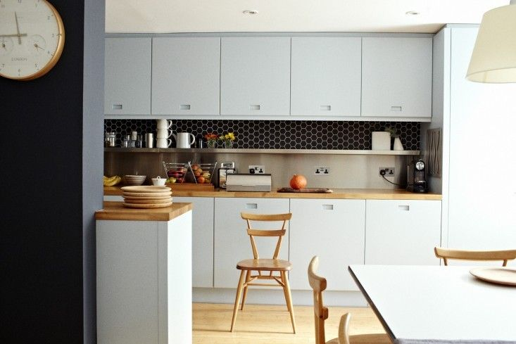 Ice blue kitchen cabinets,Ercol chair, London   Remodelista