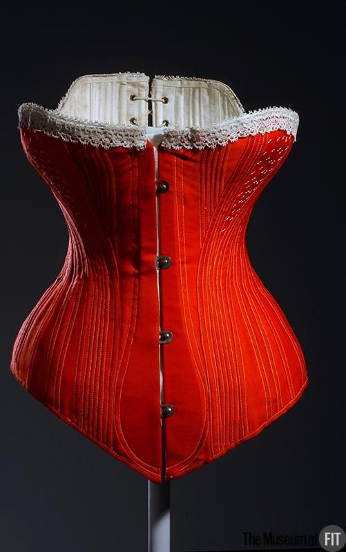 Corset. Medium: Red wool, silk, steel and whalebone. Date: c.1880. Country: France (possibly)