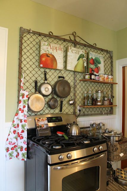 I am now on the hunt for something like this here.... it would definitely work in my very naked kitchen area!  I need this, for real.  from Hammers and High Heels, old gate used as pot/storage rack in kitchen